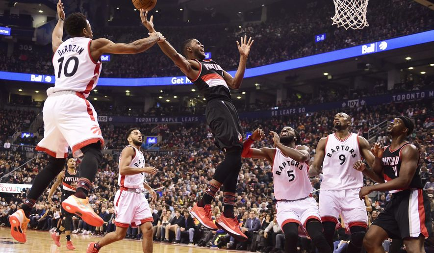 Portland Trail Blazers forward Maurice Harkless (4) is fouled by Toronto Raptors guard DeMar DeRozan (10) during first-half NBA basketball game action in Toronto, Sunday, Feb. 26, 2017. (Frank Gunn/The Canadian Press via AP)