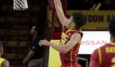 USC forward Bennie Boatwright (25) dunks against Arizona State during the second half of an NCAA college basketball game, Sunday, Feb. 26, 2017, in Tempe, Ariz. (AP Photo/Matt York)