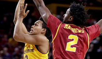 Arizona State guard Tra Holder (0) shoots over Southern California guard Jonah Mathews (2) during the second half of an NCAA college basketball game, Sunday, Feb. 26, 2017, in Tempe, Ariz. (AP Photo/Matt York)