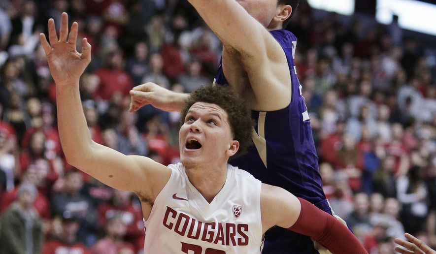 Washington State guard Malachi Flynn (22) and Washington forward Sam Timmins go after the ball during the first half of an NCAA college basketball game in Pullman, Wash., Sunday, Feb. 26, 2017. (AP Photo/Young Kwak)