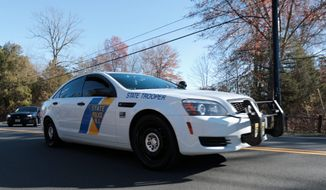 A New Jersey State Police cruiser leaves Trump National Golf Club, Friday, Nov. 18, 2016, in Bedminster, N.J. President-elect Donald Trump is expected to arrive at the golf club on Friday. (AP Photo/Julio Cortez)
