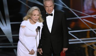 Faye Dunaway, left, and Warren Beatty present the award for best picture at the Oscars on Sunday, Feb. 26, 2017, at the Dolby Theatre in Los Angeles. (Photo by Chris Pizzello/Invision/AP)