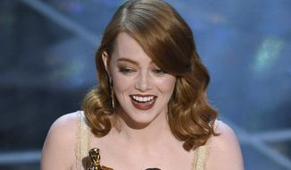 "Emma Stone accepts the award for best actress in a leading role for ""La La Land"" at the Oscars on Sunday, Feb. 26, 2017, at the Dolby Theatre in Los Angeles. (Photo by Chris Pizzello/Invision/AP)"