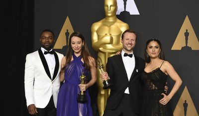 "Joanna Natasegara, second from left, and Orlando von Einsiedel, winners of the award for for best documentary short subject for ""The White Helmets"", pose in the press room with David Oyelowo, left, and Salma Hayek, right, at the Oscars on Sunday, Feb. 26, 2017, at the Dolby Theatre in Los Angeles. (Photo by Jordan Strauss/Invision/AP)"