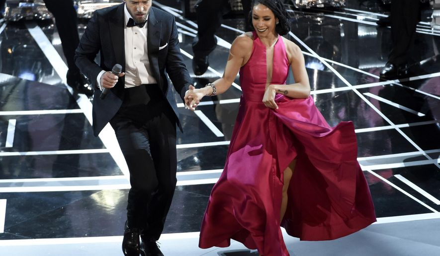 """Justin Timberlake performs songs from best original song nominee """"Can't Stop the Feeling,"""" from """"Trolls"""" at the Oscars on Sunday, Feb. 26, 2017, at the Dolby Theatre in Los Angeles. (Photo by Chris Pizzello/Invision/AP)"""