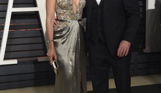Luciana Barroso, left, and Matt Damon arrive at the Vanity Fair Oscar Party on Sunday, Feb. 26, 2017, in Beverly Hills, Calif. (Photo by Evan Agostini/Invision/AP)