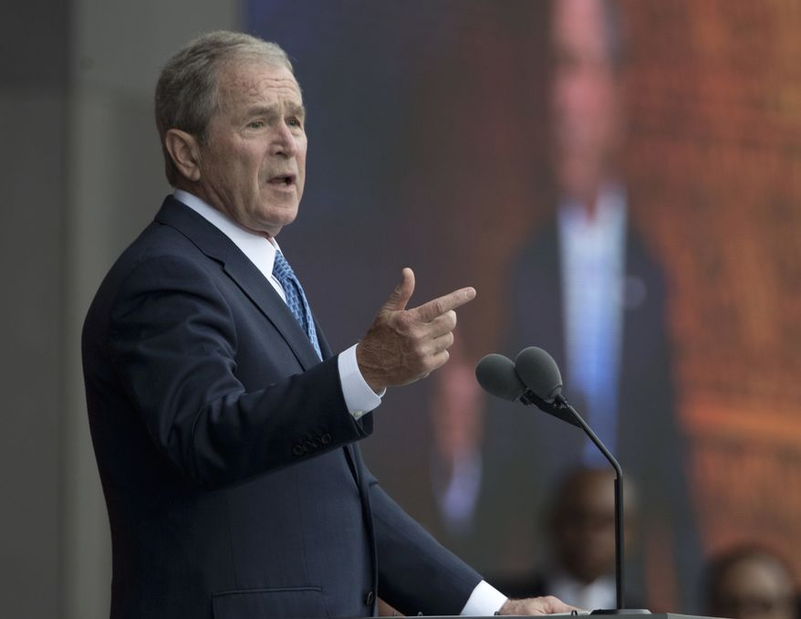 "FILE - In this Sept. 24, 2016 file photo, former President George W. Bush speaks in Washington. Bush said Monday, Feb. 27, 2017, ""we all need answers"" on the extent of contact between President Donald Trump's team and the Russian government, and he defended the media's role in keeping world leaders in check. (AP Photo/Manuel Balce Ceneta, File)"