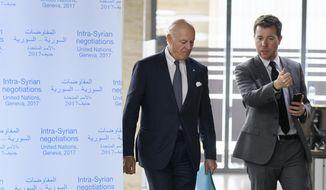 U.N. Special Envoy for Syria Staffan de Mistura, left, arrives for a meeting during Syria peace talks in Geneva, Switzerland, Monday, Feb. 27, 2017. (Fabrice Coffrini/Pool Photo via AP)