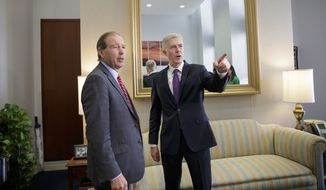 Supreme Court Justice nominee Judge Neil Gorsuch, right, meets with Sen. Tom Udall, D-N.M. on Capitol Hill in Washington, Monday, Feb. 27, 2017. (AP Photo/J. Scott Applewhite)