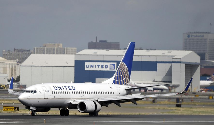 FILE - In this Sept. 8, 2015, file photo, a United Airlines passenger plane lands at Newark Liberty International Airport in Newark, N.J. United Airlines seeks to narrow gap on competitors like Delta by beefing up routes from hub airports. The airline also wants to upgrade facilities at key airports and reduce its use of smaller planes on important business-travel routes. (AP Photo/Mel Evans, File)