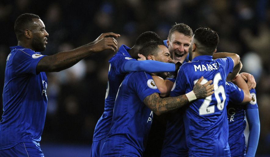 Leicester players celebrate after Leicester's Daniel Drinkwater scored during the English Premier League soccer match between Leicester City and Liverpool at the King Power Stadium in Leicester, England, Monday, Feb. 27, 2017. (AP Photo/Rui Vieira)