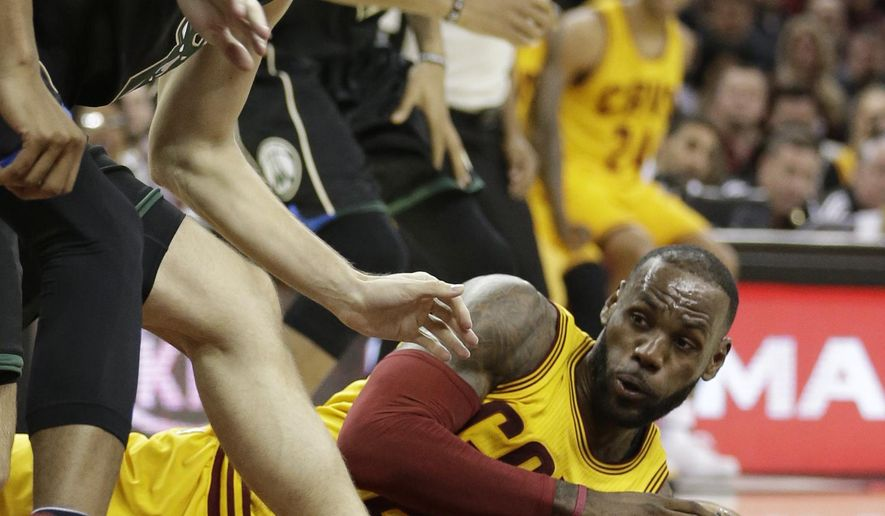 Cleveland Cavaliers' LeBron James, bottom, looks to pass under pressure from Milwaukee Bucks' Mirza Teletovic, from Bosnia, in the first half of an NBA basketball game, Monday, Feb. 27, 2017, in Cleveland. (AP Photo/Tony Dejak)