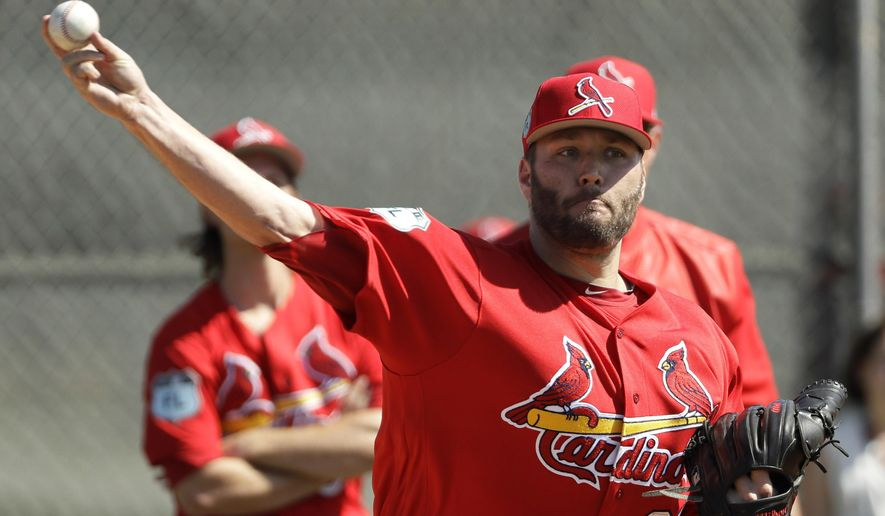 FILE - In this Feb. 17, 2017, file photo, St. Louis Cardinals starting pitcher Lance Lynn throws during a spring training baseball workout in Jupiter, Fla.  Lynn takes the mound for the Cardinals for the first time since undergoing Tommy John surgery in 2015. After missing all of last season and entering a contract year, Lynn, a former All-Star, will be counted on to bring stability to the St. Louis rotation. (AP Photo/David J. Phillip, File)