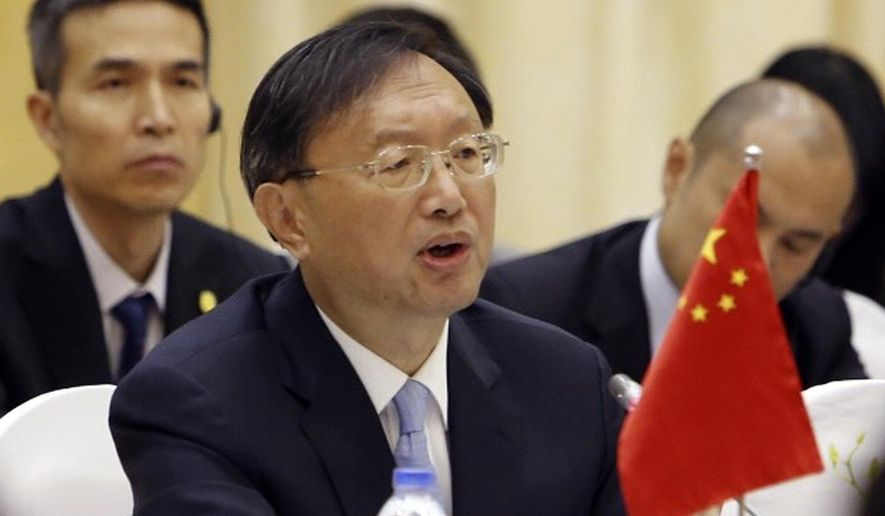 FILE - In this June 27, 2016, file photo, Chinese State Councilor Yang Jiechi speaks during a cooperation conference with Vietnamese Foreign Minister Pham Binh Minh in Hanoi, Vietnam. Yang will meet with U.S. high-ranking officials becoming the first senior Chinese official to visit the United States on Monday, Feb. 27, 2017 since President Donald Trump took office. (AP Photo/Tran Van Minh, File)