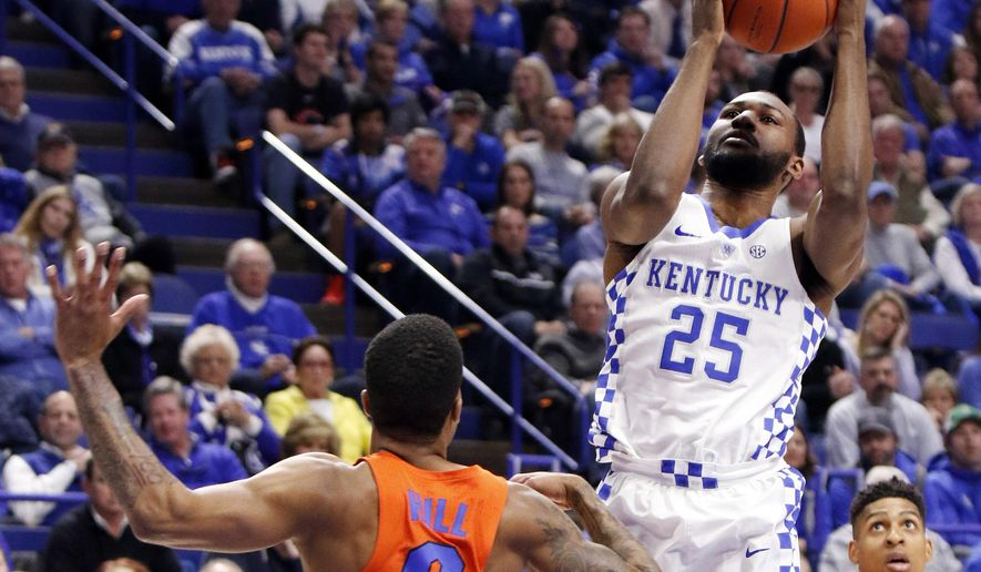 Kentucky's Dominique Hawkins (25) shoots while defended by Florida's Kasey Hill (0) during the first half of an NCAA college basketball game, Saturday, Feb. 25, 2017, in Lexington, Ky. (AP Photo/James Crisp)