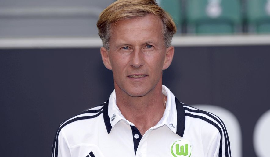 FILE - In this July 18, 2013 file photo Wolfsburg's assistant coach Andries Jonker is pictured during an official photo call for the season 2013/14 at the Volkswagen-Arena in Wolfsburg, Germany. Jonker is said to become the new coach of Bundesliga soccer club VfL Wolfsburg after coach Valerien Ismael was fired, Sunday, Feb. 26, 2017. (Peter Steffen/dpa via AP, file)