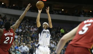 Dallas Mavericks guard Seth Curry (30) shoots against Miami Heat center Hassan Whiteside (21) during the second half of an NBA basketball game in Dallas, Monday, Feb. 27, 2017. The Mavericks won 96-89. (AP Photo/LM Otero)