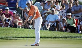 Rickie Fowler reacts as he watches his putt on the 12th hole during the final round of the Honda Classic golf tournament, Sunday, Feb. 26, 2017, in Palm Beach Gardens, Fla. Fowler won the tournament. (AP Photo/Wilfredo Lee)