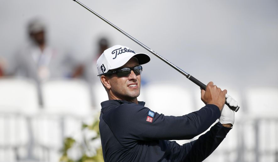 Adam Scott, of Australia, tees off on the 17th tee during the first round of the Honda Classic golf tournament, Thursday, Feb. 23, 2017, in Palm Beach Gardens, Fla. (AP Photo/Wilfredo Lee)