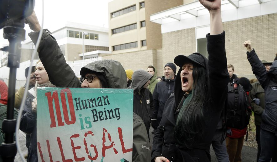 Protestors chant during a rally in Portland, Ore., Monday, Feb. 27, 2017. Immigrants and their supporters met outside the Immigration and Customs Enforcement building in downtown Portland to protest President Trump's immigration policies. (AP Photo/Don Ryan)