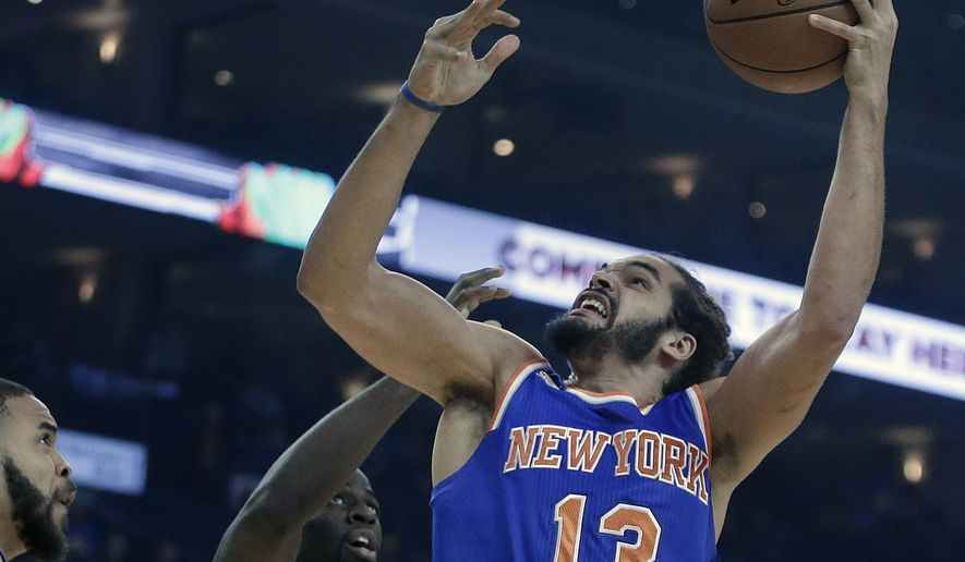 FILE - In this Dec. 15, 2016, file photo, New York Knicks' Joakim Noah, right, shoots against Golden State Warriors' Draymond Green, center, and JaVale McGee during the first half of an NBA basketball game in Oakland, Calif. Brandon Jennings is gone and Joakim Noah is headed for knee surgery. If the New York Knicks are going to make a playoff push, it will come without two of the key veterans they signed last summer.(AP Photo/Ben Margot, File)