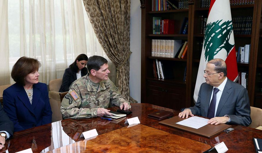 In this photo released by the Lebanese Government, Lebanese President Michel Aoun, right, meets with U.S. Central Command Chief Gen. Joseph Votel, center, and U.S. Ambassador to Lebanon Elizabeth Richard, left, at the Presidential Palace in Baabda, east of Beirut, Lebanon, Sunday, Dec. 18, 2016. (Dalati Nohra/Lebanese Government via AP)