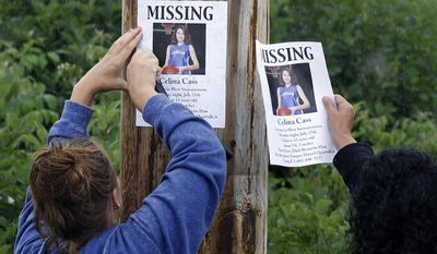 FILE - In this July 28, 2011 file photo, Lori McKearney, of Lancaster, N.H., right, and Kaylin Pettit, of Stewartstown, N.H., post missing posters for 11-year-old Celina Cass in Colebrook, N.H. She was reported missing from her home on July 26, 2011, and her body was recovered from the Connecticut River six days later. Her stepfather Wendell Noyes was charged with second-degree murder in her death. A court in Lancaster ruled Monday, Feb. 27, 2017, that Noyes was not competent to stand trial in Cass' death and charges were dropped. McKearney is Celina Cass's aunt. (AP Photo/Charles Krupa, FIle)