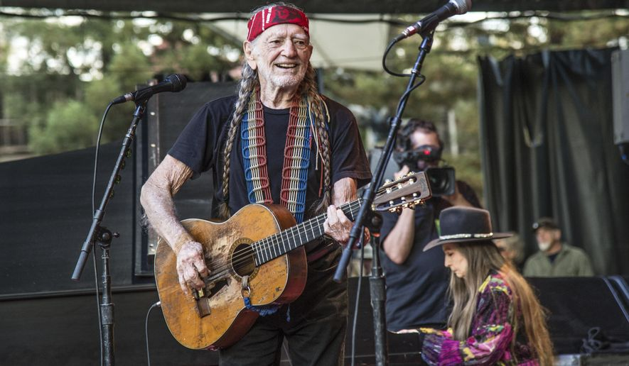 FILE - This Oct. 23, 2016 file photo shows country legend Willie Nelson performing at the 30th Annual Bridge School Benefit Concert in Mountain View, Calif. Fellow country singer Merle Haggard will be honored a year after his death with an all-star concert featuring his longtime friend and duet partner Willie Nelson as well as Kenny Chesney, Miranda Lambert and John Mellencamp. Haggard died of pneumonia on April 6, 2016, in Palo Cedro at the age of 79. (Photo by Amy Harris/Invision/AP)