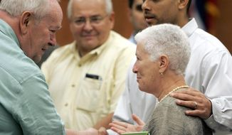 FILE- In this June 23, 2005, file photo, former Neshoba County newspaper publisher Stanley Dearman, left, greet Rita Schwerener Bender, and her son, Gabriel Bender, right, in Philadelphia, Miss., following the conviction and sentencing of Edgar Ray Killen, for the 1964 slayings of three civil rights workers. Dearman, who pushed for justice in the murders of three civil rights workers, died on Saturday, Feb. 25, 2017, in Florida. (AP Photo/Rogelio Solis, File)
