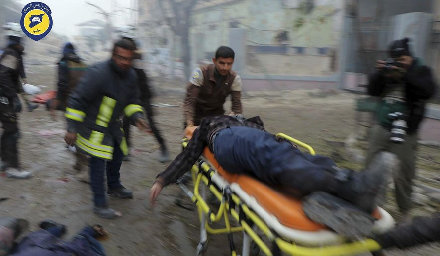 "FILE -- In this Nov. 30, 2016 file photo provided by the Syrian Civil Defense White Helmets, which has been authenticated based on its contents and other AP reporting, shows Civil Defense workers carrying a victim on a stretcher after artillery fire struck the Jub al-Quba district in Aleppo, Syria. Politics continued to pervade the Academy Awards Sunday as the 40-minute Netflix documentary ""The White Helmets"" took the best documentary short award. The denial of entry into the U.S. for the film's 21-year-old Syrian cinematographer put ""The White Helmets"" in the broader spotlight. (Syrian Civil Defense White Helmets via AP, File)"