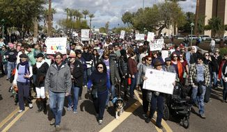 FILE - In this Jan. 21, 2017, file photo, thousands of demonstrators march in Phoenix in support of those in cities around the globe protesting against Donald Trump as the new United States president. The speaker of the Arizona House says he will not hear a bill that makes participating in or helping organize a protest that turns into a riot an offense that could lead to criminal racketeering charges. (AP Photo/Ross D. Franklin, File)