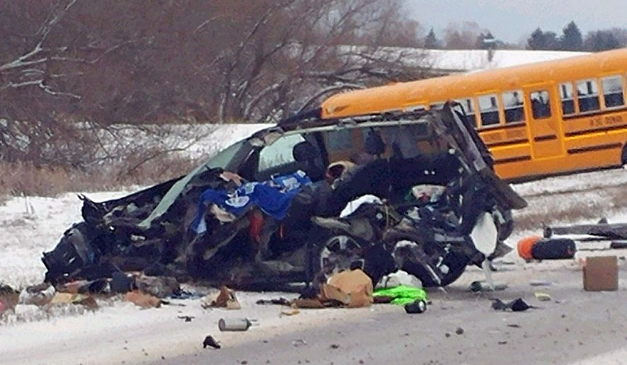 This photo provided by the Lake County Sheriff's office shows a sport utility vehicle after it collided with a Ronan school bus on U.S. Highway 93 Monday, Feb. 27, 2017, just north of Ronan, Mont. The driver of a sport utility vehicle died after the SUV collided with the school bus.  Officials believe none of the children were injured. (Don Bell/ Lake County Sheriff via AP)