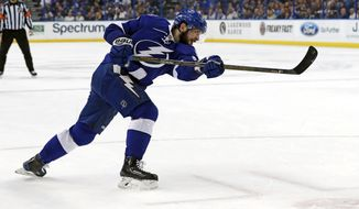 Tampa Bay Lightning's Nikita Kucherov, of Russia, follows through on a shot to score his third goal of the second period of an NHL hockey game against the Ottawa Senators on Monday, Feb. 27, 2017, in Tampa, Fla. (AP Photo/Mike Carlson)