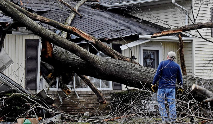 In a Saturday, Feb. 25, 2017 photo, a house in the 100 block of Mountain Spring Road in Clay Township, Lancaster, Pa., is severely damaged by a fallen tree during a storm. The National Weather Service says a tornado touched down in northeastern Pennsylvania as storms swept through the region over the weekend, but other damage in central Pennsylvania was due to straight-line winds.  (Blaine Shahan/LNP via AP)