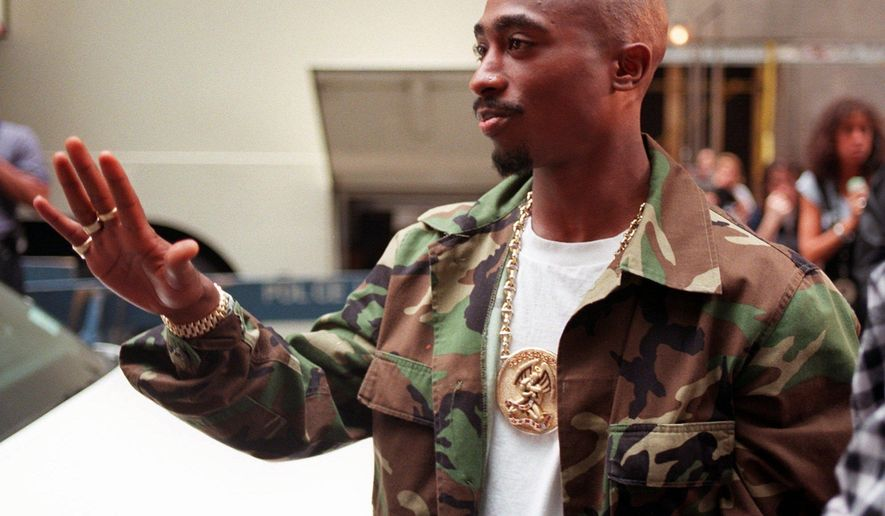 FILE - In this Sept. 4, 1996, file photo, rapper Tupac Shakur arrives at New York's Radio City Music Hall three days before being fatally shot in Las Vegas. The car in which Shakur was shot was listed for sale for $1.5 million on Feb. 21, 2017, by a California memorabilia dealer. (AP Photo/Todd Plitt, File)
