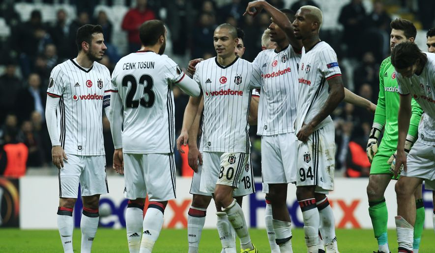 Besiktas' players celebrate following a Europa League round of 32 second leg soccer match between Besiktas and Hapoel Beer-Sheva in Istanbul, Thursday, Feb. 23, 2017. Besiktas won the match 2-1. (AP Photo/Lefteris Pitarakis)