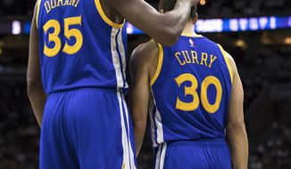 Golden State Warriors' Kevin Durant, left, pats Stephen Curry, right on the head after he misses the lay-up during the first half of an NBA basketball game against the Philadelphia 76ers, Monday, Feb. 27, 2017, in Philadelphia. (AP Photo/Chris Szagola)=