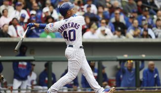 Chicago Cubs' Willson Contreras hits a home run during the fourth inning of a spring training baseball game against the Chicago White Sox Monday, Feb. 27, 2017, in Mesa, Ariz. (AP Photo/Morry Gash)