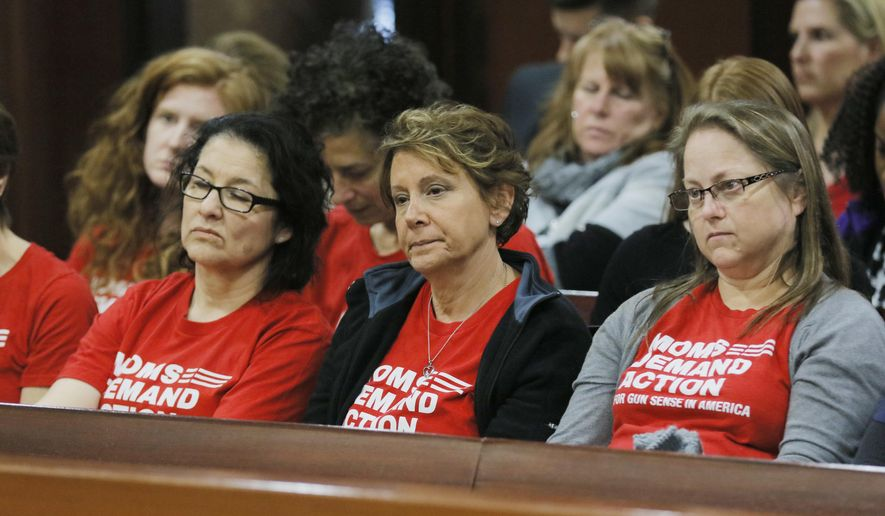 """Woman from the group Moms Demand Action watch as the campus Carry bill advances Monday, Feb. 27, 2017, at the legislature in Atlanta. With little fanfare, the House Public Safety and Homeland Security Committee om Monday approved what has become known as the """"Campus Carry"""" bill. Ballinger is the sponsor of HB 280, which allows anyone with a Georgia weapons permit to carry firearms onto most parts of public college and university campuses.  (Bob Andres/Atlanta Journal-Constitution via AP)"""