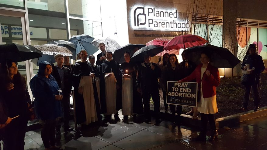 In this file photo, two dozen pro-life activists maintained a vigil in the rain outside of a Planned Parenthood facility in the District Tuesday, the first day of a planned national 40 Days for Life annual campaign during Lent, which will see activists stationed outside abortion clinics nationwide from now until Easter weekend. (Bradford Richardson/The Washington Times) **FILE**