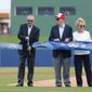 Major League Baseball commissioner Rob Manfred (left) cuts the ceremonial ribbon to open The Ballpark of the Palm Beaches as Washington Nationals owner Ted Lerner and his wife Annette look on before Tuesday's spring training game. (Associated Press)