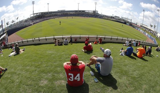 Fans enjoy the view from outfield during a spring training baseball game between Washington Nationals and Houston Astros at newly opened The Ballpark of the Palm Beaches in West Palm Beach, Fla., on Tuesday, Feb. 28, 2017. The game was the first to be played in the new stadium which will serve as both club's spring training home. (AP Photo/John Bazemore) **FILE**