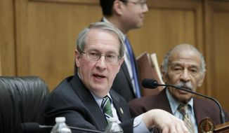 House Judiciary Committee Chairman Bob Goodlatte, R-Va., center, and Rep. John Conyers, D-Mich., ranking member, work during a markup session on the Protecting Access to Care Act on Capitol Hill in Washington, Tuesday, Feb. 28, 2017. (AP Photo/J. Scott Applewhite)