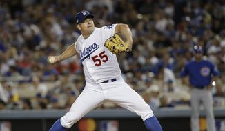 FILE - In this Oct. 28, 2016, file photo, then-Los Angeles Dodgers relief pitcher Joe Blanton throws during the seventh inning of Game 3 of the National League baseball championship series against the Chicago Cubs, in Los Angeles. A person with knowledge of the deal tells The Associated Press that reliever Joe Blanton and the Washington Nationals have agreed to a $4 million, one-year contract. The person spoke to the AP on condition of anonymity on Tuesday, Feb. 28, 2017.  because the agreement had not been announced. (AP Photo/David J. Phillip, File)