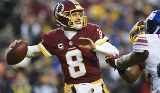 FILE - In this Jan. 1, 2017 file photo, Washington Redskins quarterback Kirk Cousins (8) passes during the first half of an NFL football game against the New York Giants in Landover, Md. In a move that seemed the most likely at this point in the odd dance between Kirk Cousins and the Washington Redskins, the team placed the exclusive franchise tag on the starting quarterback on Tuesday. (AP Photo/Nick Wass, File)