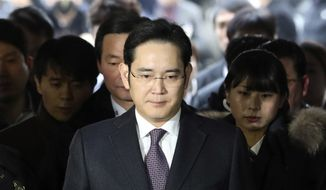 Lee Jae-yong, front, a vice chairman of Samsung Electronics Co., arrives for the hearing at the Seoul Central District Court in Seoul, South Korea, in this Jan. 18, 2017, file photo. (AP Photo/Lee Jin-man, File)