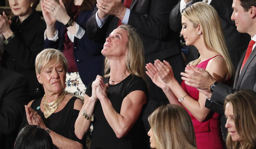 Carryn Owens, widow of widow of Chief Special Warfare Operator William Ryan Owens, is applauded on Capitol Hill in Washington, Tuesday, Feb. 28, 2017, as she was acknowledged by President Donald Trump during his address to a joint session of Congress.  (AP Photo/Pablo Martinez Monsivais)
