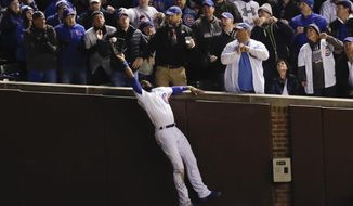 FILE - In this Oct. 30, 2016, file photo, Chicago Cubs right fielder Jason Heyward catches a fly ball hit by Cleveland Indians' Trevor Bauer during the third inning of Game 5 of the Major League Baseball World Series in Chicago. The photo was honored by the Associated Press Sports Editors as best sports action photo of 2016 at their annual winter meeting in Lake Buena Vista, Fla. (AP Photo/Charles Rex Arbogast, File)