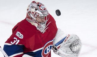 Montreal Canadiens goalie Carey Price makes a save against the Columbus Blue Jackets during the second period of an NHL hockey game, Tuesday, Feb. 28, 2017 in Montreal. (Paul Chiasson/The Canadian Press via AP)