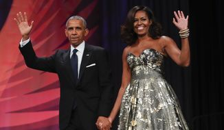 Then-President Barack Obama and first lady Michelle Obama attended the Congressional Black Caucus Foundation's 46th Annual Legislative Conference Phoenix Awards Dinner in Washington, Sept. 17, 2016. (Associated Press) ** FILE **